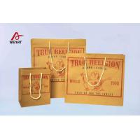 China Customized Kraft Recycled Paper Gift Bags LOGO Printing Yellow Color Foil Surface on sale