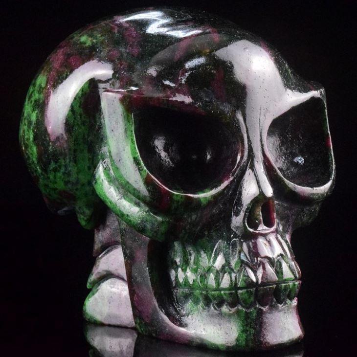 China Natural Carved Ruby Gemstone Crystal Alien Skulls for Sale on sale